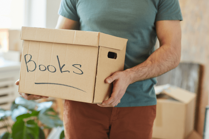 Get Rid of Books, Holding Box of Books for Donation