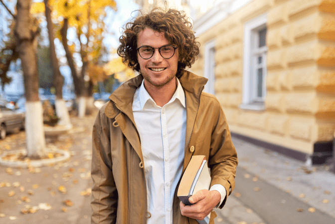 Get Rid of Books, Man Holding Books Outdoors