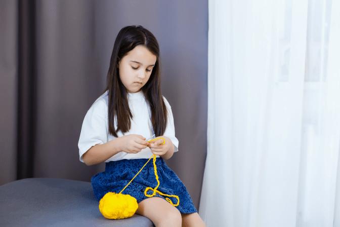 Grief Hoarding to Shoebox Memories, Little Girl Crocheting