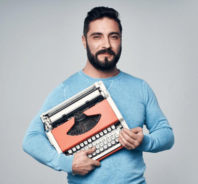Grief Hoarding to Shoebox Memories, Man Holding Typewriter