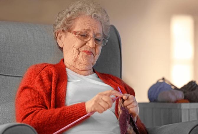 Grief Hoarding to Shoebox Memories, Woman Knitting