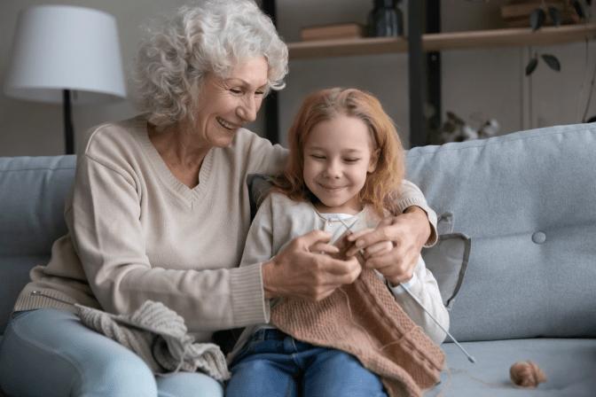 Grief Hoarding to Shoebox Memories, Woman Teaching Little Girl to Knit.35-min