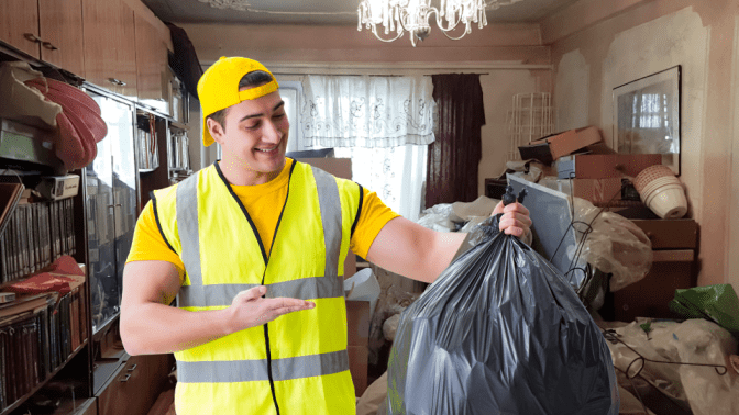 Hoarding Cleanup A New Way to Help, Man in Hoarding House with Trash Bag