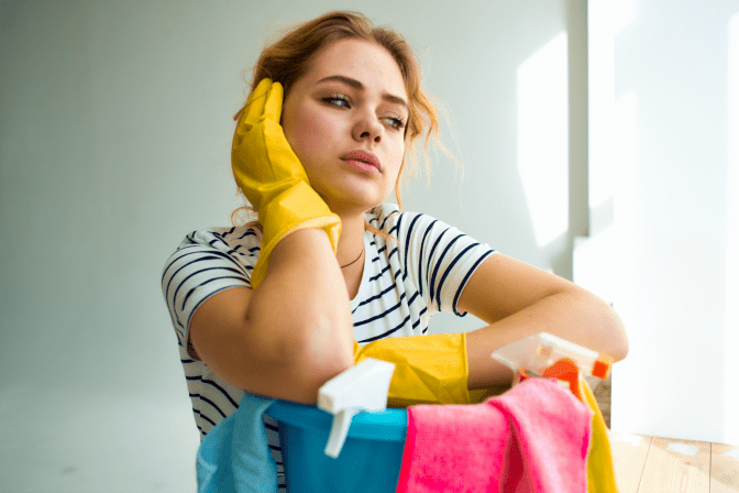 How to Charge for a Hoarding Job, Woman Thinking with Cleaning Supplies